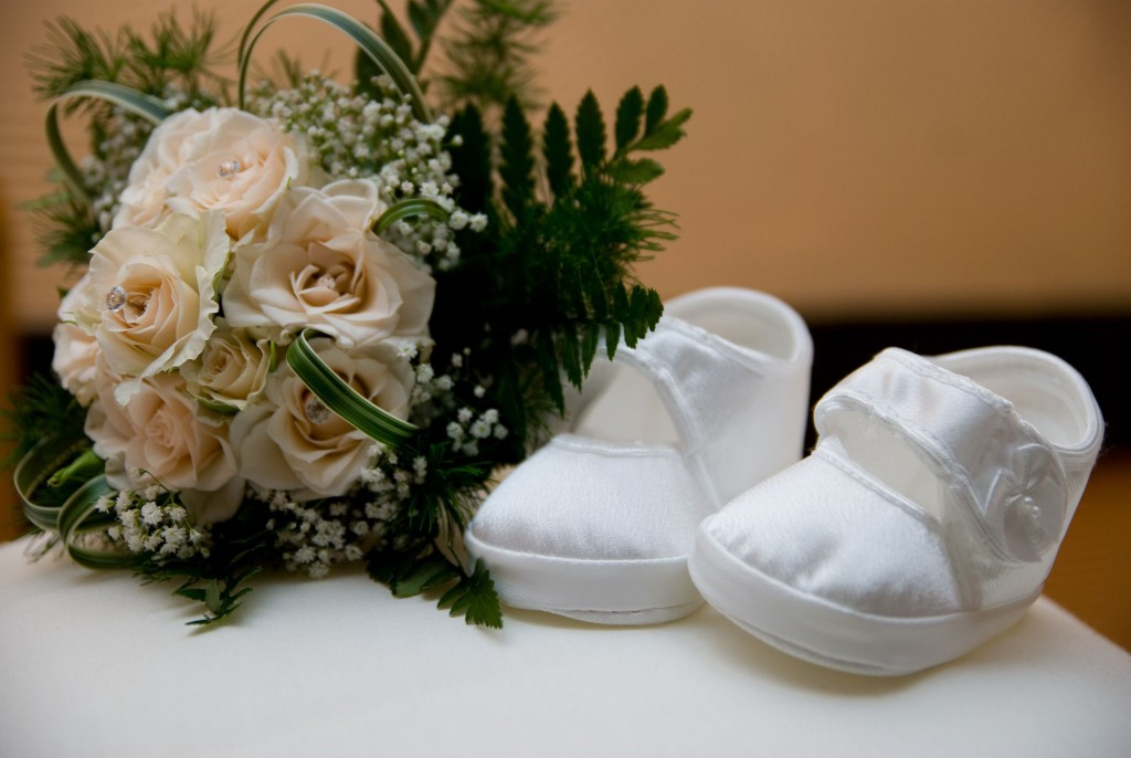 17869842 - christening shoes and bunch of roses
